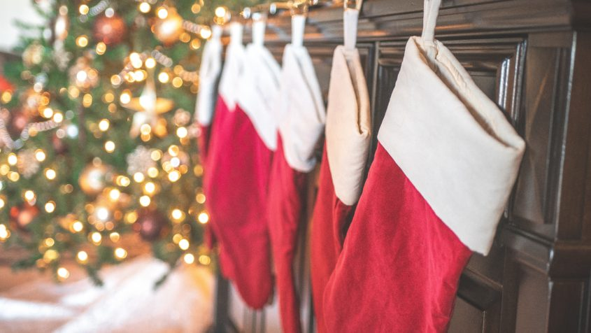 Up your Christmas stocking game by making a new Christmas tradition. The easy and inexpensive decorating tradition will bring you memories and fun for years to come. Stepmom | stepfamilies | christmas traditions | family traditions | DIY Christmas | DIY stockings